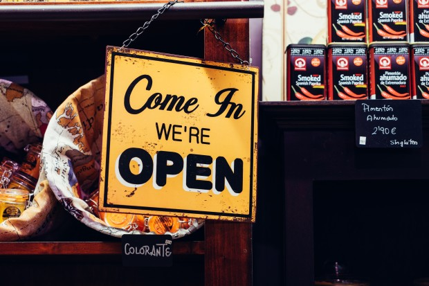 Shop sign saying We are open. Photo by Álvaro Serrano on Unsplash